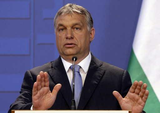 El primer ministro húngaro Viktor Orban reacciona durante una conferencia de prensa conjunta con el canciller austríaco en Budapest, el 26 de julio de 2016. (AFP PHOTO / PETER KOHALMI)
