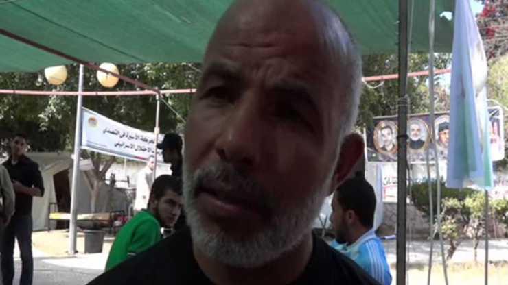 Tawfiq Abu Naim, el jefe del comité de terroristas árabes encarcelados, fue liberado en el acuerdo de intercambio de prisioneros de Shalit hace un año (crédito de la foto: captura de pantalla, YouTube)