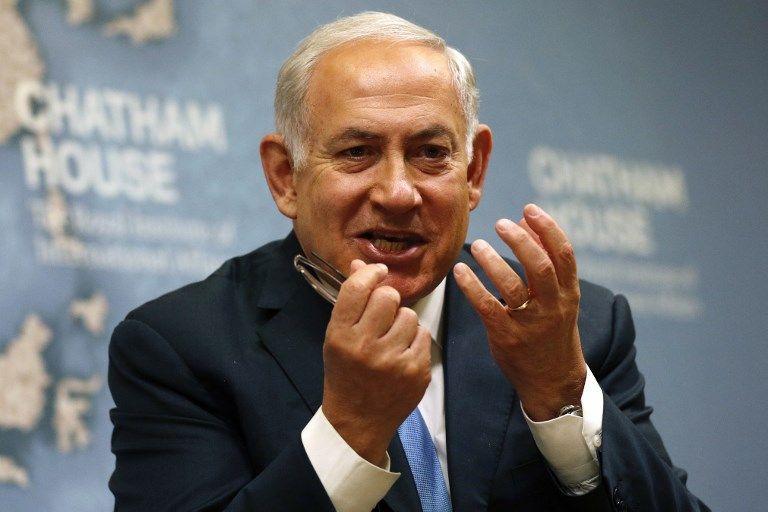El primer ministro Benjamin Netanyahu diserta sobre la política exterior de Israel en Chatham House, el Real Instituto de Asuntos Internacionales, en Londres, el 3 de noviembre de 2017. (AFP Photo / Adrian Dennis)