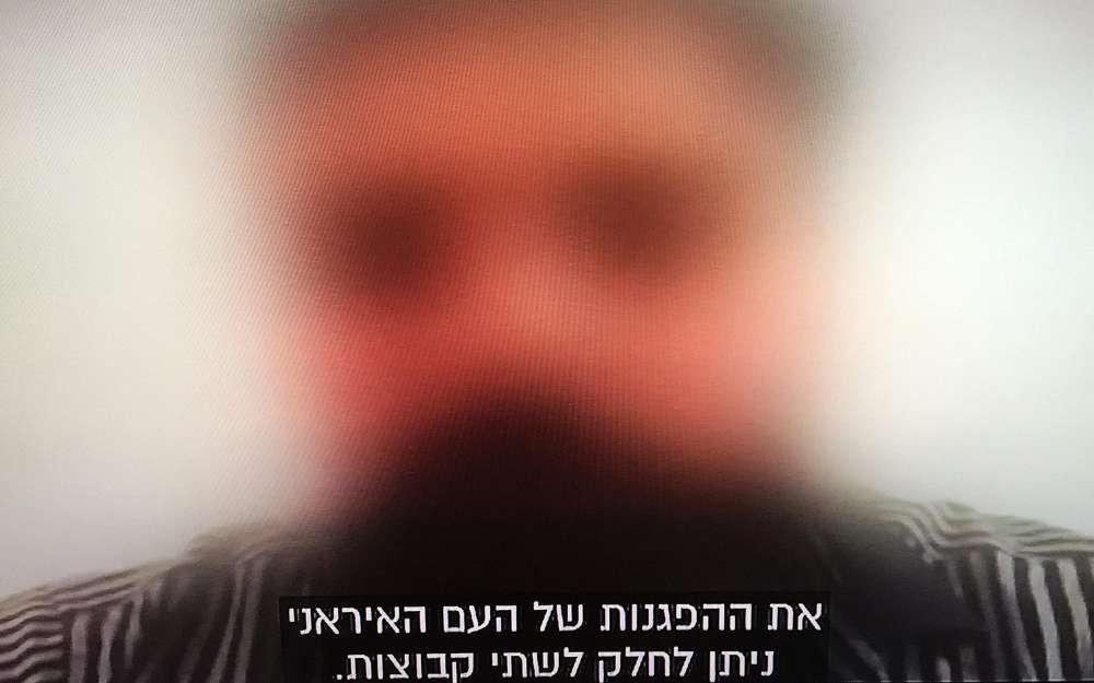 Muhsan, un manifestante contra el régimen en Teherán, habla sobre las noticias del Canal 10 de Israel el 31 de diciembre de 2017 (captura de pantalla del Canal 10)