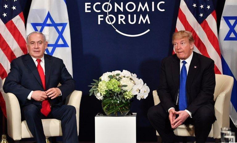 El presidente de los Estados Unidos, Donald Trump, y el primer ministro, Benjamin Netanyahu, se reúnen en el marco del Foro Económico Mundial en Davos, Suiza, el 25 de enero de 2018 (AFP Photo / Nicholas Kamm)