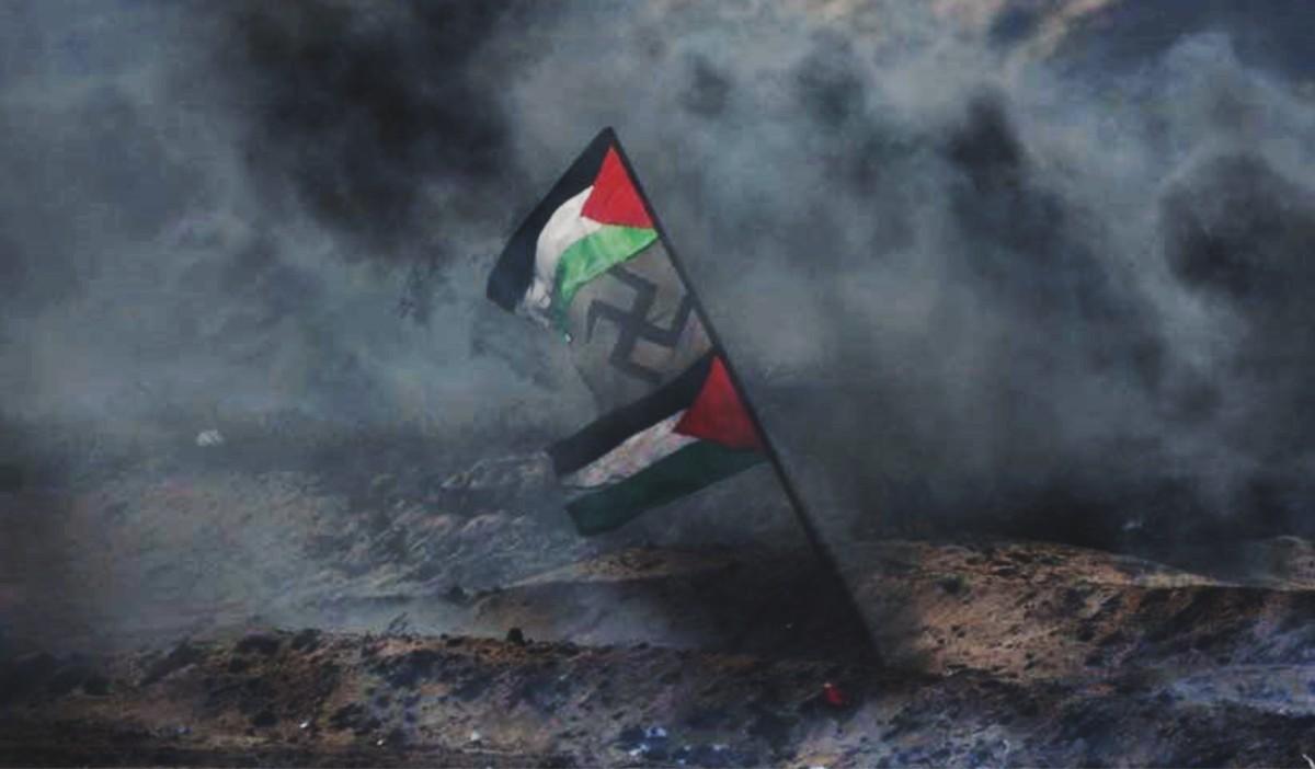 Banderas de la revuelta árabe en versión de la Autoridad Palestina y una cruz svástica se ven en medio del humo negro de las manifestaciones en Gaza, el 6 de abril de 2018 (Unidad de portavoz de las FDI)