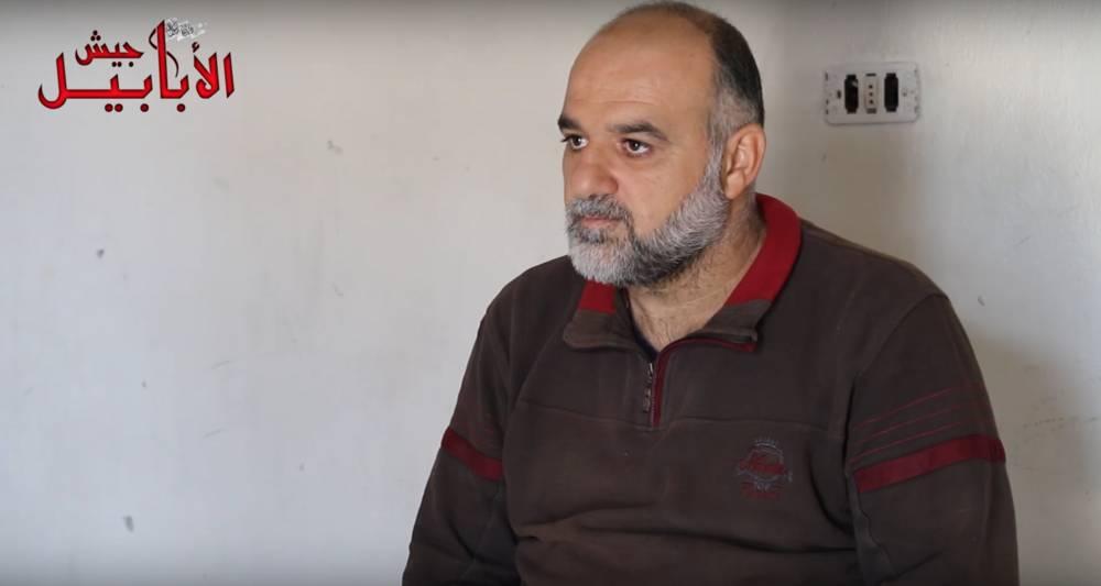 Marwan Awad al-Jubor, un presunto miembro sirio de Hezbolá, que fue capturado por los rebeldes sirios y confesó haber lanzado cohetes contra Israel y esperar la orden de hacerlo nuevamente el 1 de mayo de 2018. (Captura de pantalla, YouTube)