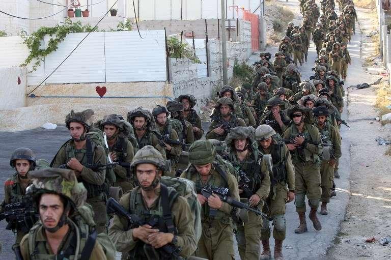 Soldados de las FDI en Hebrón el 17 de junio de 2014. (AFP Photo / Hazem Bader)