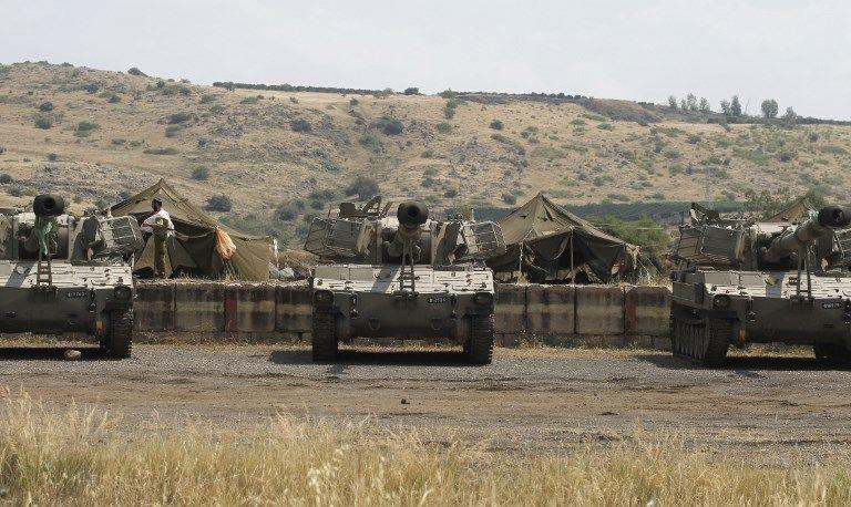 Una unidad de artillería israelí toma posición cerca de la frontera con Siria en los Altos del Golán el 9 de mayo de 2018. (Jalaa Marey / AFP)