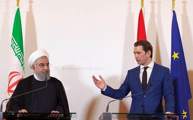 El canciller de Austria Sebastian Kurz y el presidente iraní Hassan Rouhani (izq.) Dan una conferencia de prensa conjunta en la Cancillería de Viena el 4 de julio de 2018. (AFP Photo / Alex Halada)