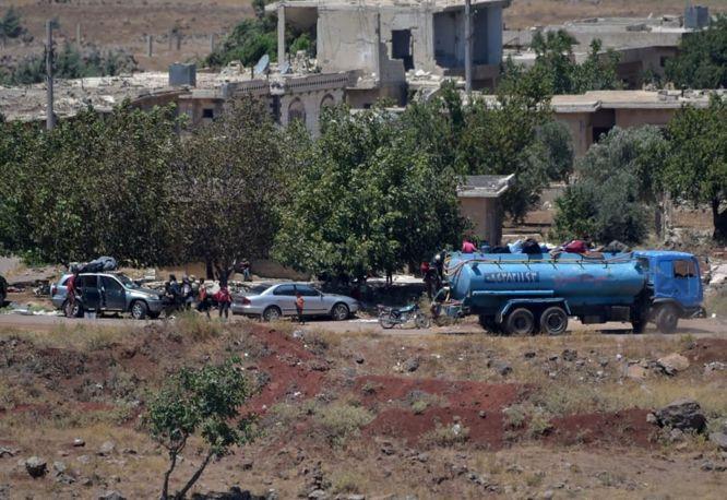 Rebeldes que salen de Quneitra en el lado sirio de los Altos del Golán, el 20 de julio de 2018. Crédito: Gil Eliahu