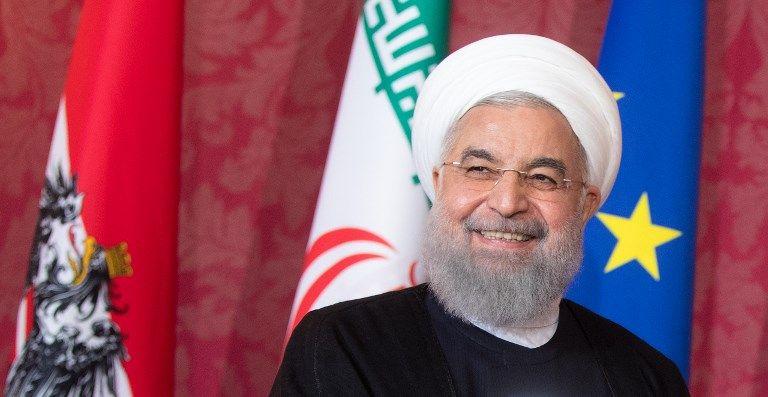 El presidente iraní, Hassan Rouhani, escucha durante una conferencia de prensa conjunta con el presidente de Austria, tras las conversaciones del 4 de julio de 2018 en el Palacio de Hofburg en Viena.(AFP PHOTO / APA / GEORG HOCHMUTH)