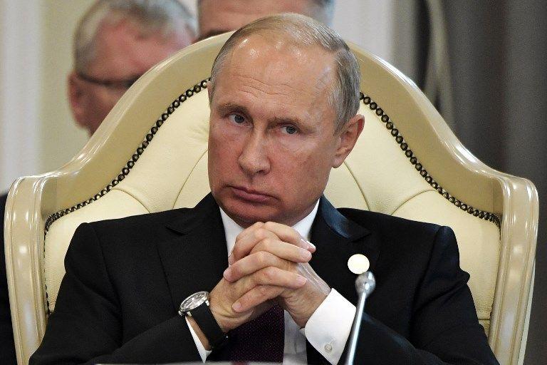 El presidente ruso, Vladimir Putin, asiste a la sesión plenaria de la V Cumbre del Caspio en Aktau el 12 de agosto de 2018. (AFP PHOTO / Sputnik / Alexey NIKOLSKY)