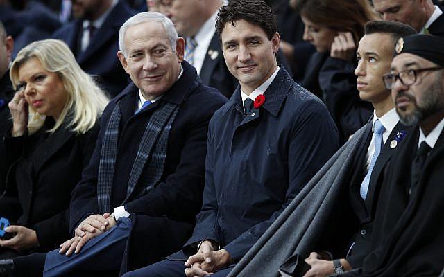 El primer ministro Benjamin Netanyahu, segundo a la izquierda, y su esposa Sara, a la izquierda, el primer ministro canadiense Justin Trudeau, el rey marroquí Mohammed VI, a la derecha y el príncipe heredero Moulay Hassan asisten a las ceremonias en el Arco de Triunfo el domingo, 11 de noviembre de 2018 en París. (Foto AP / Francois Mori, Piscina)