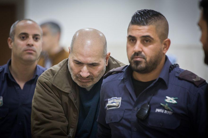 Jamil Tamimi, el hombre palestino que asesinó a la estudiante británica Hannah Bladon el 14 de abril de 2017 en Jerusalén, es llevado a una audiencia en el Tribunal de Distrito de Jerusalén, el 31 de diciembre de 2018 (Yonatan Sindel / Flash90)