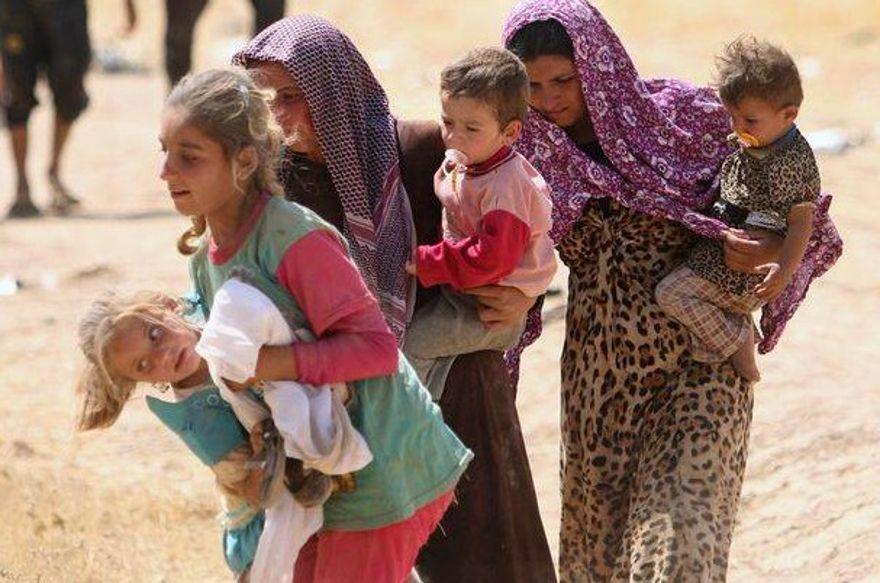 Mujeres yazidi que llevan a sus hijos el 1 de enero de 2015 (Cortesía de Nareen Shammo)