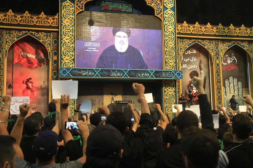 Los partidarios de Hezbollah vieron un discurso del líder Hassan Nasrallah en Beirut el 2 de septiembre. El Sr. Nasrallah amenazó con nuevos ataques contra Israel. FOTO: AGENCE FRANCE-PRESSE / GETTY IMAGES